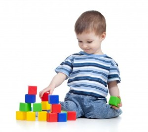 boy playing w blocks, verticle stock